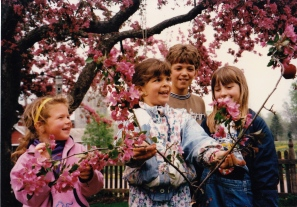 Marnie, and neighbors Brianna, Devin, and Jacquline posing with some apple blossoms