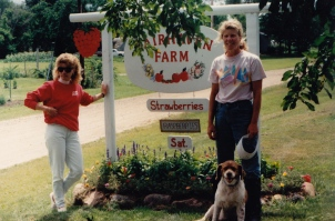 Marsha and her sister Connie pose next to our new sign